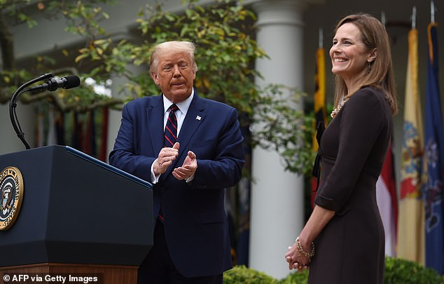 Trump nominated Barrett (right) to the vacant Supreme Court seat on Saturday, and one day later he was forced to defend his choice and her religion.