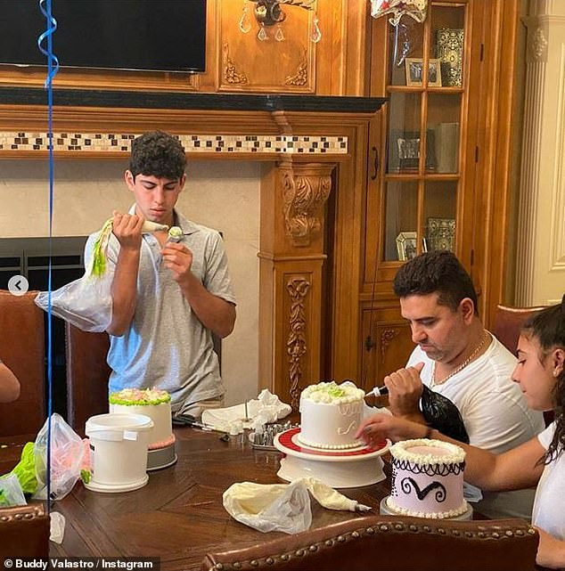 Focus: His team placed on his family's wooden dining table and held the piping bag tightly while he ran the intricate details on the cake