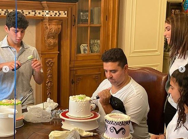 Once again: Cake Boss Buddy Valastro is back at work as he trained to decorate a cake with his left hand on Saturday, after a horrific bowling accident at home