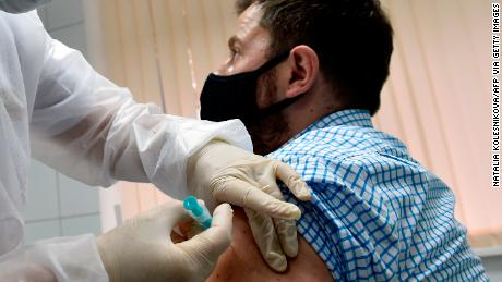 Volunteer Ilya Dubrovin, 36, gets an injection in a Russian human trial of Sputnik's fifth coronavirus vaccine at a Moscow clinic in September.