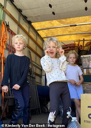 She shared a snapshot of her children from inside a moving truck
