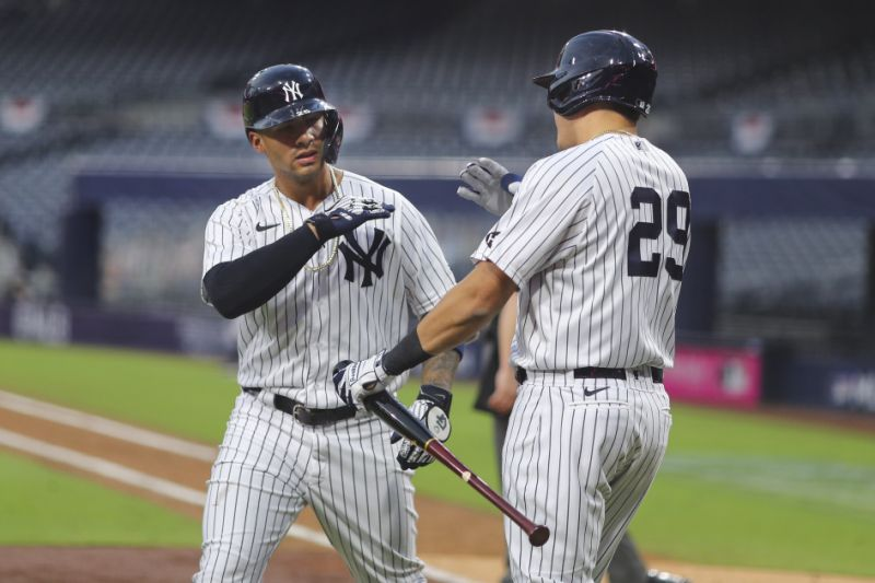 The New York Yankees' Gleyber Torres celebrates with Gio Urshela after scoring a double in the sixth game during Game 4 of ALDS. (Photo by Alex Trautwig / MLB Photos via Getty Images)