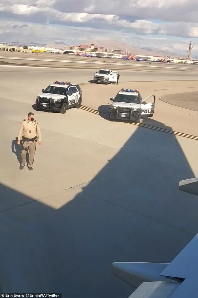 As police officers were on their way to him, he moved towards the vertical wing of the plane