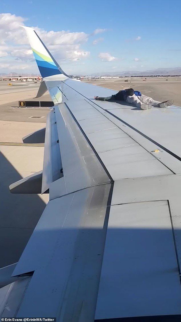 At some point, the man decided to lie on the wing of the plane