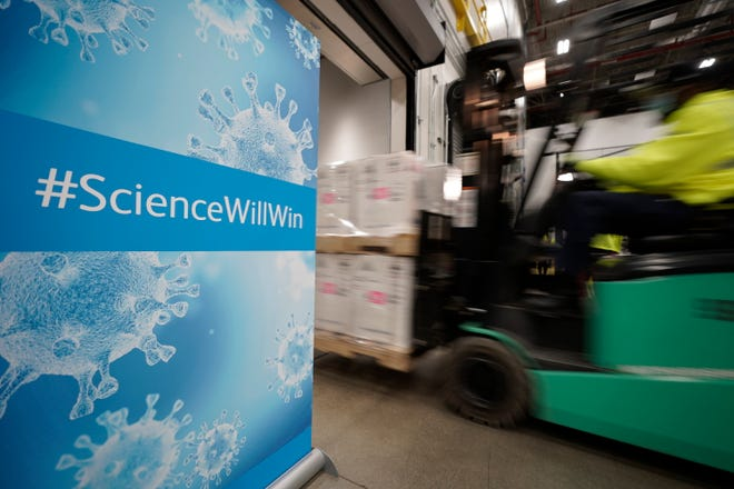 Boxes containing the Pfizer-BioNTech COVID-19 vaccine are loaded onto a cargo truck Sunday at the Pfizer Global Supply plant in Portage, Michigan.
