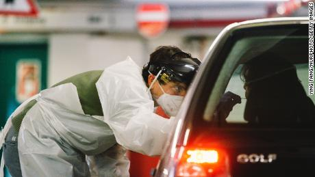 Medical workers conduct antigen tests at the Lanxess Arena in Cologne, Germany, on December 14th.