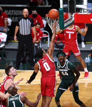 Wisconsin Demetric Trace shoots Michigan State in the second half at Priceline Center on December 25, 2020 in East Lansing.