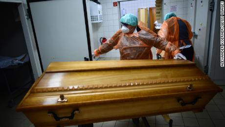Funeral home workers move coffins of Covid-19 victims in Annaberg-Buchholz, Saxony, on December 7, as the country witnesses a new spike in infections and deaths.