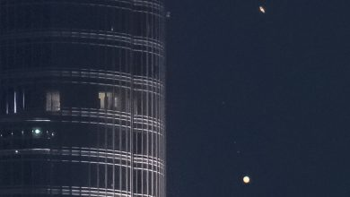 "Photo of Jupiter and Saturn descend on the tallest building in the world in an epic video entitled ""A Great Coupling."""