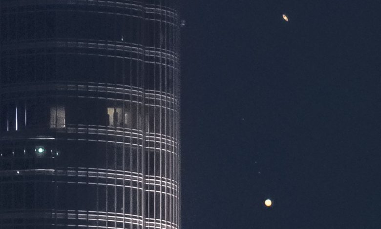 """Jupiter and Saturn descend on the tallest building in the world in an epic video entitled """"A Great Coupling."""""""