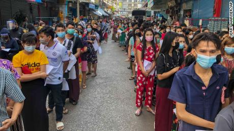 People queue for Covid-19 tests in Samut Sakhon, Thailand, on Sunday, December 20, 2020.