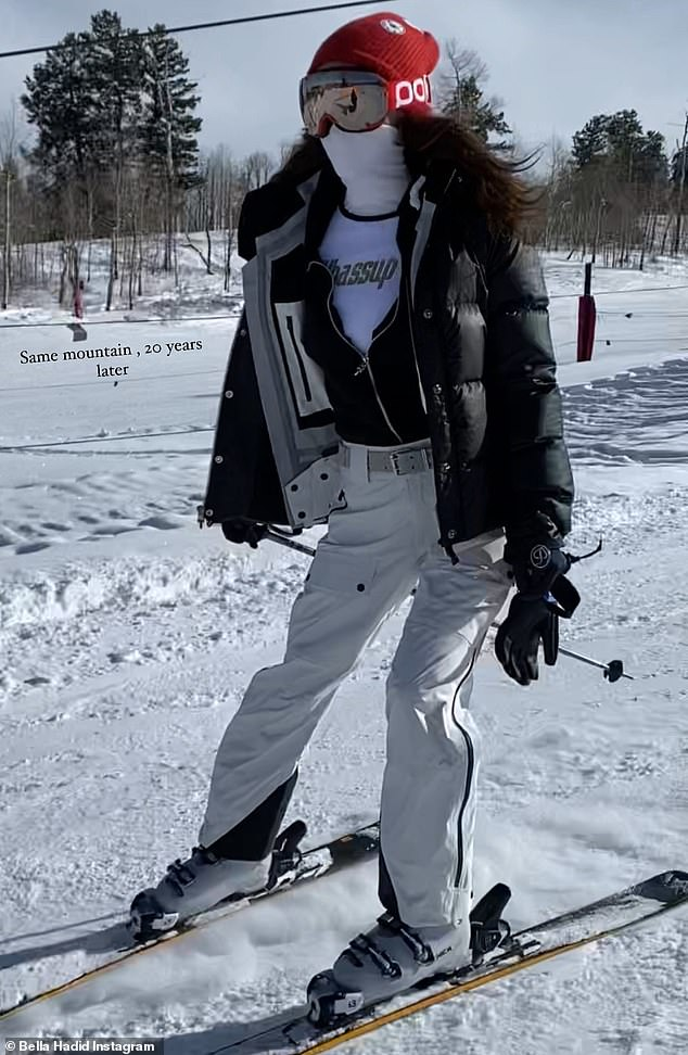 Skiing elegance: She vanished into her ski look, rocking several layers of black and white with a red beanie, mirrored red goggles and a white face mask