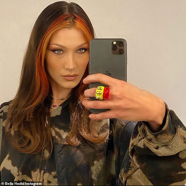 Informal glamor: Bella Hadid wore her glamorous look on Sunday with a casual headdress in an impromptu selfie mirror she posted on Instagram, after she revealed a new red hairstyle.