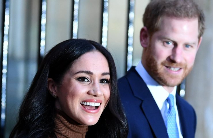 Harry and Meghan are smiling