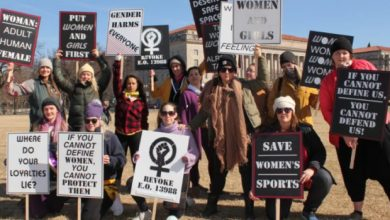 Photo of American activists and women's rights activists protest against Biden