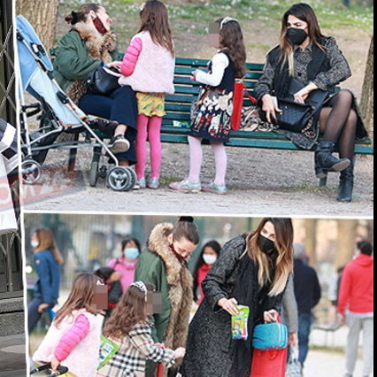 Cecilia Capriotti between games in the park and shopping with her daughter