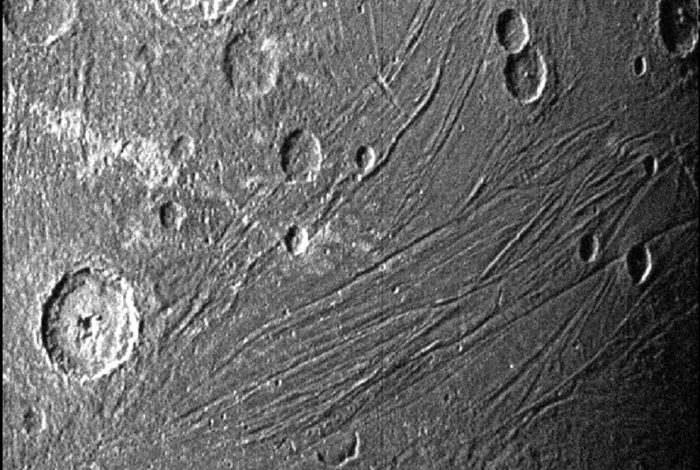Craters and fractures on the largest moon in the solar system - space and astronomy