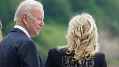 """Photo of Jill Biden and the word """"LOVE"""" on the jacket: """"We bring love from America"""""""