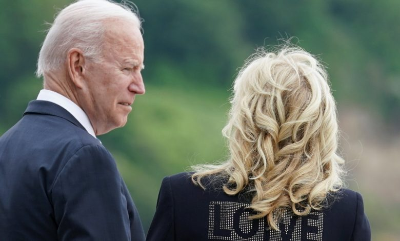 """Jill Biden and the word """"LOVE"""" on the jacket: """"We bring love from America"""""""