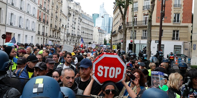 Anti-vaccination protesters gather during a demonstration in Paris, France on Saturday, August 7, 2021.