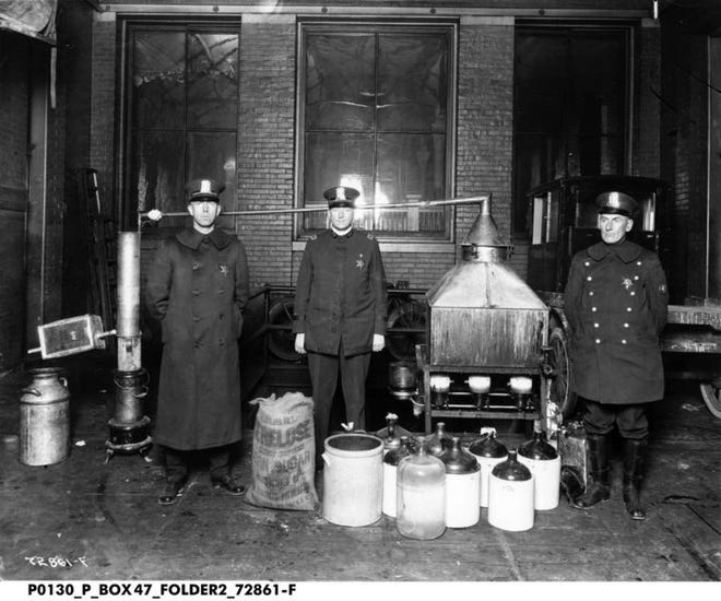 Indiana cops stand with illegal distillation equipment at the time during Prohibition.  Indiana Historical Society exhibition opening