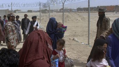 """Photo of """"Afghans welcome"""" and """"No to thousands of arrivals.""""  struggle over refugees"""