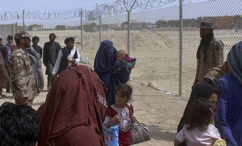 """""""Afghans welcome"""" and """"No to thousands of arrivals.""""  struggle over refugees"""